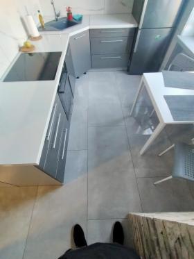 Położenie i zafugowanie podłogi i fartucha w kuchni., oferta