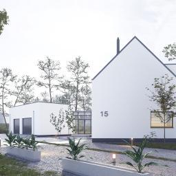 Nowoczesna stodoła. Pomiędzy garażem o budynkiem mieszkalnym zaprojektowaliśmy przeszklony łącznik, pozwalający od wejścia cieszyć się ogrodem leśnym w głębi działki