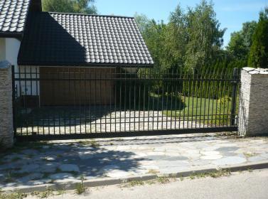 Ogrodzenia Ryn - Bramy Garażowe Segmentowe Ławki